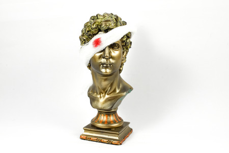 bloodied: Golden Male Statuettes with white gauze of bloodied Stock Photo