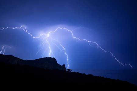 Powerful multiple thunderbolt over the Black sea coast in Crimea Stock Photo