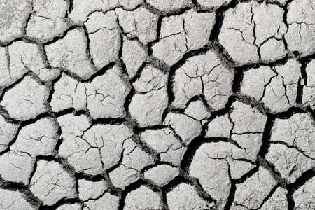 Detail view of cracked mud from the top 스톡 콘텐츠