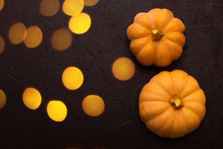 Pumpkins on black table. Halloween  with pumpkin and bokeh blurred lights.