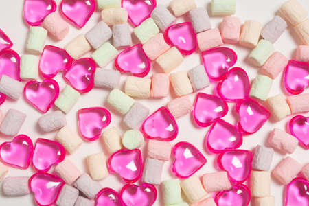 heart shaped lollipops and colorful marshmallow candies Reklamní fotografie