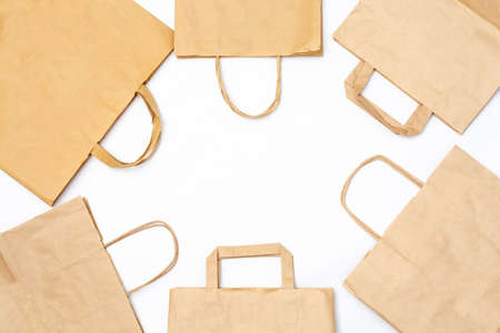 Craft paper recyclable bags on white background with copy space for your text. Zero waste shopping and plastic free concept