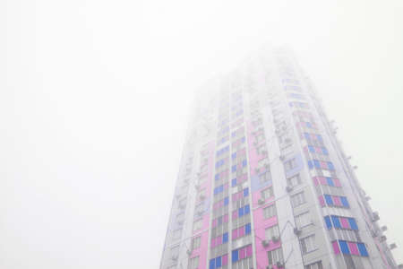 Sleeping urban district during bad visibility foggy weather Imagens