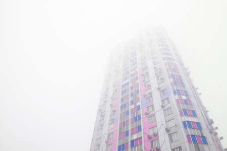 Sleeping urban district during bad visibility foggy weather 版權商用圖片