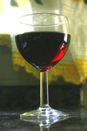 A filled wine glass photo