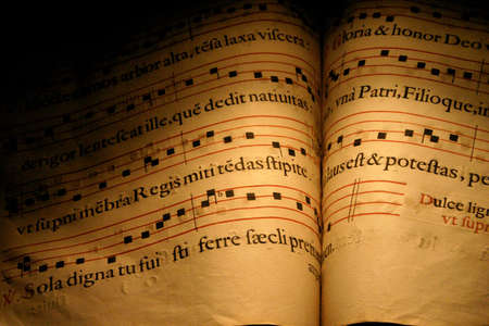 An old Christian Hymn book, normally used in choirs with musical notes and written in Latin Stock Photo - 217801
