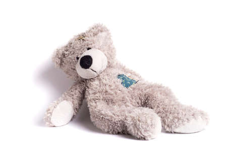 teddy bear with a patch on a white background Stock Photo