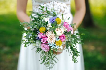 Bride holding flower bouquet close up Reklamní fotografie