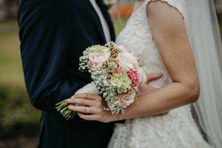 Bride holding flower bouquet close up