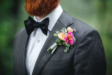 Boutonniere, groom wearing flowers on his jacket