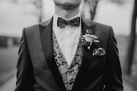 Groom wearing a bow tie at a wedding