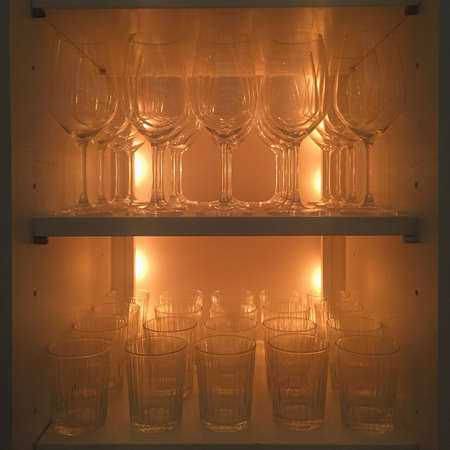 shelve: A shelve with goblets and glass with warm light Stock Photo