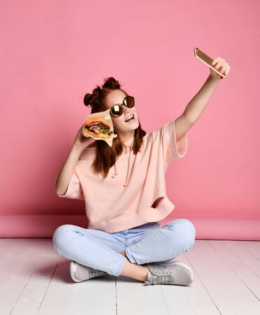 Woman Taking Selfie While Making Smile With Burger