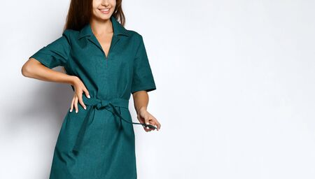 Cropped photo of model in a green urban dress-shirt . Lovely girl in romantic clothes goes on a date, to the office, to a meeting. Urban fashion. Imagens