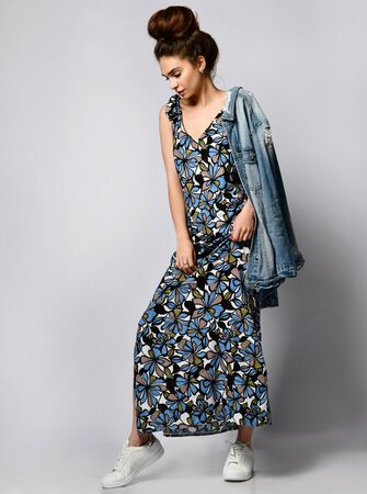 beauty woman beautiful face wearing dark silk flower dress long slim body uniform and waisted jacket on her shoulder, catalog of the summer collection of the studio brunette curly hair date clothes walk casual fashion