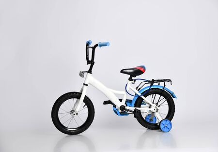 Kids blue and white bicycle isolated on white background Imagens
