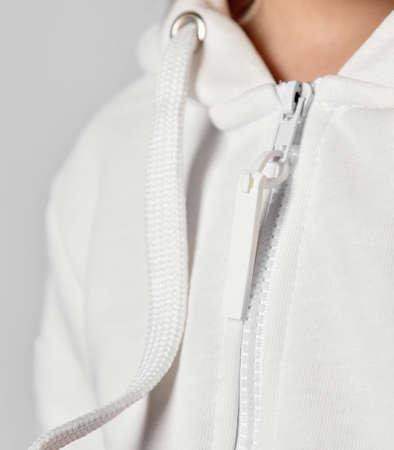 Close up detail of womens sports jacket with zipper. Textile background and fabric background texture. Zipper unzipping clothes and baring a caucasian skin.