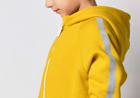 Closeup shot of warm jumpsuit hood on boy model