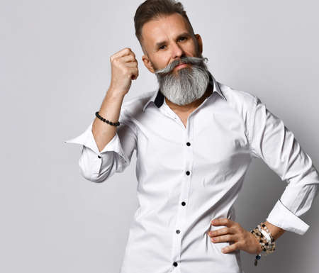 Stylish bearded hipster man showing call me gesture