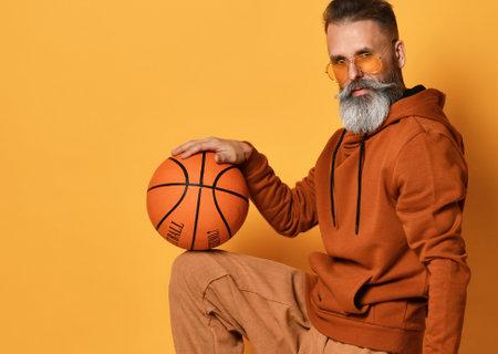 bearded man in sportswear caught basket ball