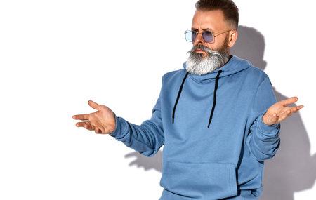 Annoyed emotional bearded man looking at camera Zdjęcie Seryjne