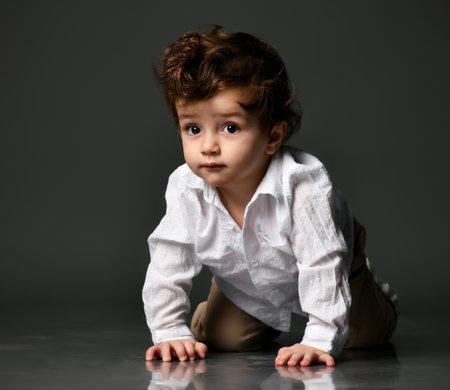 Stylish fashion baby boy portrait isolated on gray Zdjęcie Seryjne