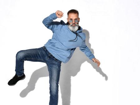 Casual stylish mature bearded man posing for camera