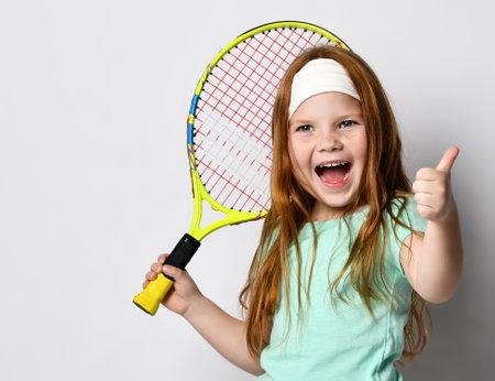 Happy excited girl big tennis player headshot studio portrait Stock Photo