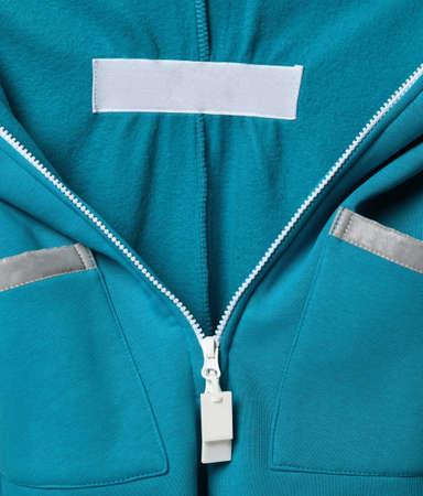 close detail of kids hoodie sweatshirt with zip fastener.
