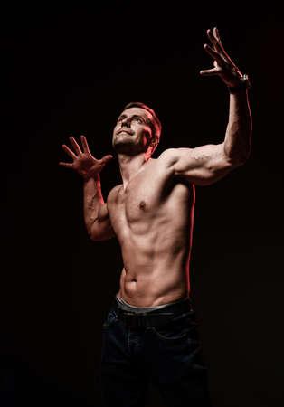 the very muscular handsome guy on black background, torso Foto de archivo