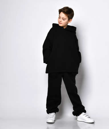Fashionable sporty kids, healthy leisure, happy childhood. Full length portrait isolated on light grey