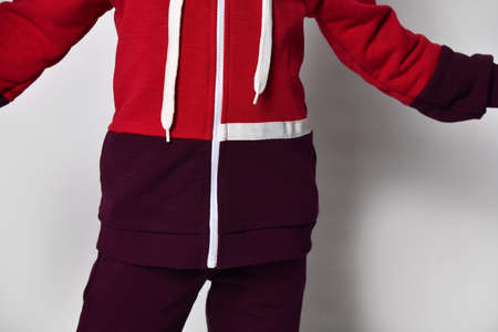 Red and burgundy color fleece sports suit closeup studio shot 版權商用圖片