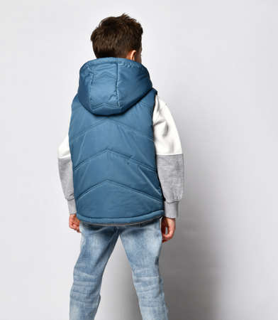Boy in casual blue outwear sleeveless vest with hood back view studio shot
