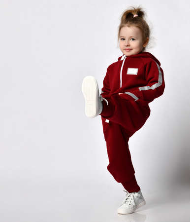 Cute red-haired girl in a comfortable tracksuit