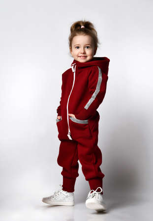 Cute little preschooler girl in tracksuit sportswear studio portrait 版權商用圖片