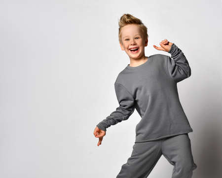 Little boy child with european appearance fooling around Standard-Bild