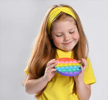 Little red-haired girl child with showing surprised emotion