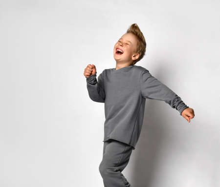 Little boy child with european appearance running away