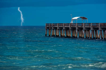 lightning strikes over the ocean  long single exposure  Delray Beach, Florida, United States photo