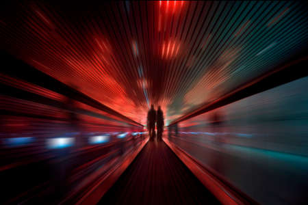 Abstract speed motion in red and green lights tunnel, fast moving toward the light  Standard-Bild