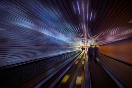Abstract speed motion in blue and orange lights tunnel, fast moving toward the light