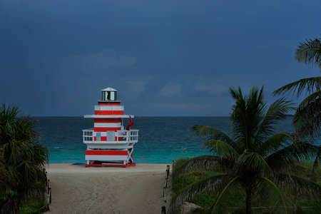 Tropical beach twilight with dramatic sky and blue waters at Miami South Beach, Florida, United States