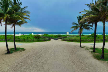 Tropical beach sunset with dramatic sky and blue waters at South Beach Miami, Florida, United States