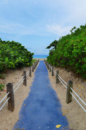 Walkway leading to the beach and ocean, South Beach Miami, Florida