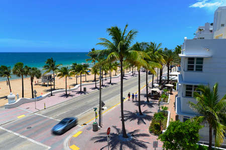 Sunrise Beach in Ft Lauderdale with palm trees and beach entry feature