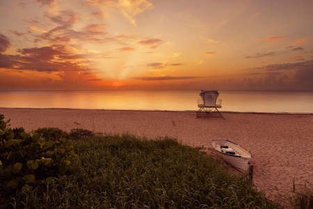 Tropical beach at beautiful sunrise  Nature background with lifeguard station and boat at Palm Beach, Florida, United States  Standard-Bild
