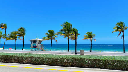 Sunrise Beach in Ft Lauderdale with palm trees and beach entry feature  photo