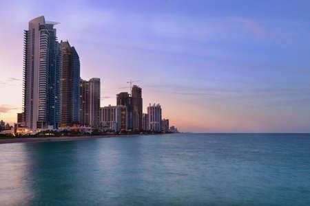isles: Beautiful beach sunset with condominiums and skyscraper in Sunny Isles Beach, Miami, Florida, United States Stock Photo