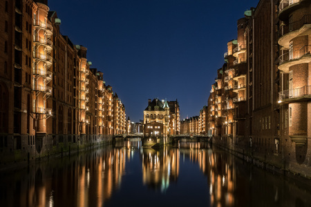 Hamburg Speicherstadt at blue hour. The blue sky and the color of the lights is a nice interaction.