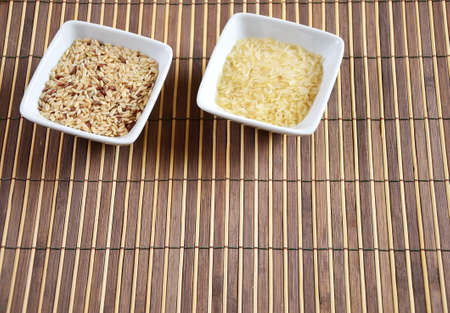 bowl of raw rice on bamboo tablecloth